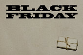 Black friday hot sale.  The inscription is black Friday on craft paper with a gift, a place for text advertising and banner.