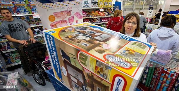Black Friday shopper Jerrelyn Madden stands behind her full shopping cart in the checkout line for over an hour after waiting in line to get in and...