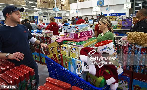 Black Friday shoppers wait in the checkout line over an hour after waiting in line to get in and then fighting huge crowds at the ToysRUs store at...