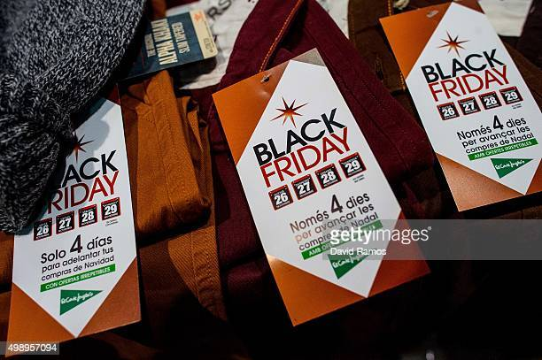 'Black Friday' tags hang from clothes inside El Corte Ingles department store during 'Black Friday' discounts on November 27 2015 in Barcelona Spain...