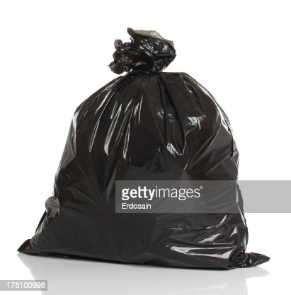 Black garbage bag isolated over white bacground : Stock Photo