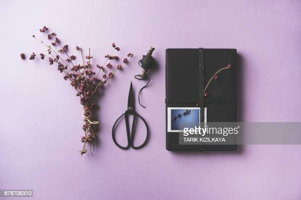 Black gift box flat lay on purple background