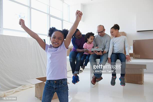 Black girl cheering in new home
