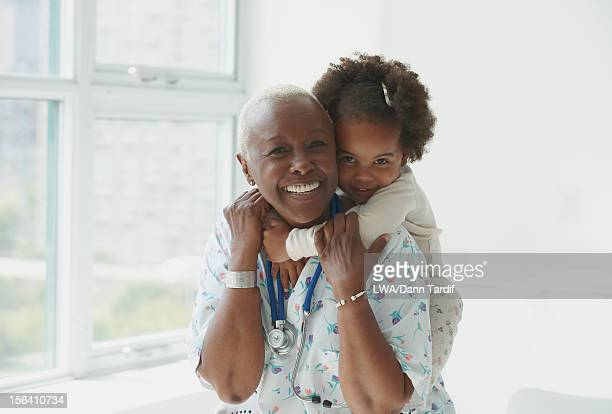 Black girl hugging nurse