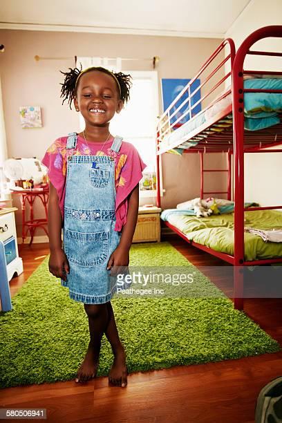 Black girl smiling in bedroom