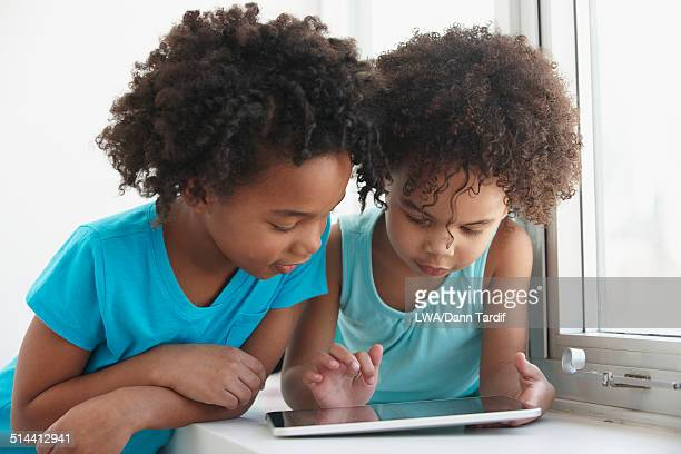 Black girls using tablet computer