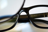 focused on black glasses in white background