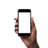 Black hand holding a smartphone with blank screen isolated on white background