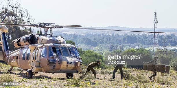 Black Hawk helicopter from Israeli armys Medevac unit lands during a drill on November 20 2015 in the southern coastal town of Zikim The drill...