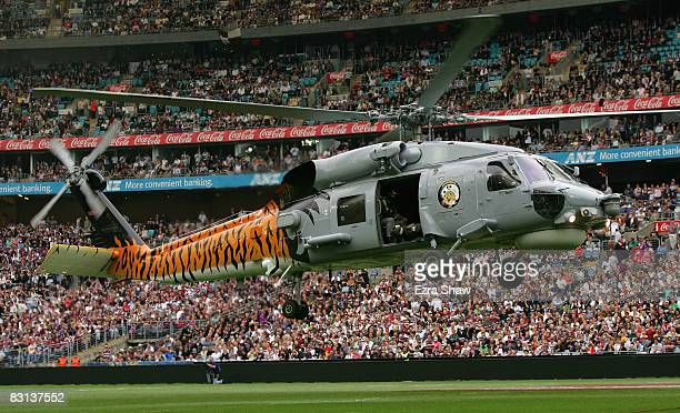Black Hawk helicopter lands in the stadium to drop off the NRL Premiership trophy before the NRL Grand Final match between the Manly Warringah Sea...