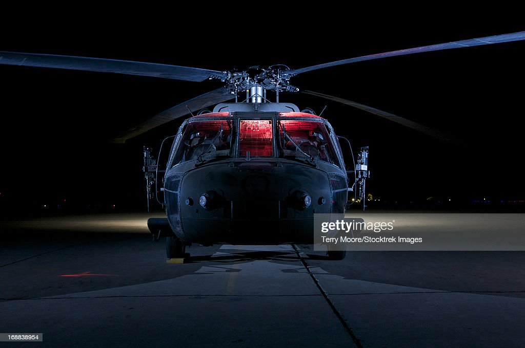 A UH-60 Black Hawk helicopter lit up by multiple external flash units, Tikrit, Iraq.