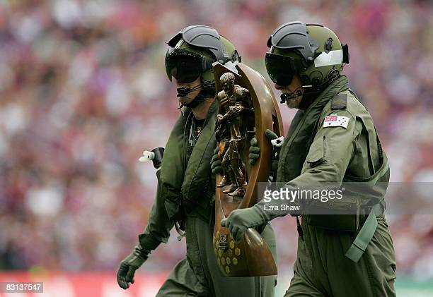 Black Hawk helicopter pilots carry the NRL Premiership trophy before the NRL Grand Final match between the Manly Warringah Sea Eagles and the...