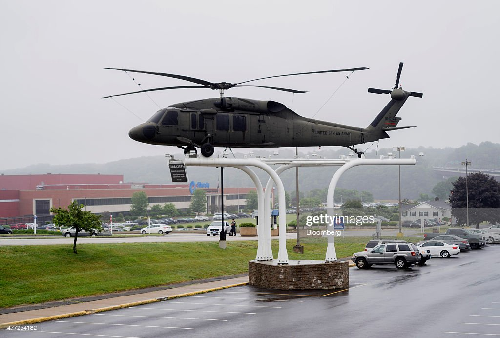 Black Hawk helicopter sits mounted in front of the United Technologies Corp Sikorsky helicopter plant in Stratford Connecticut US on Monday June 15...