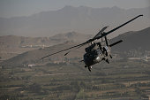 Black Hawk makes up part of a convoy of helicopters taking the media and British Prime Minister David Cameron to the Presidential Palace from Kabul...