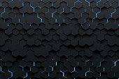 Abstract background with black hexagons illuminated from back by blue light. Many randomly arranged hexagonal shapes. 3d illustration.