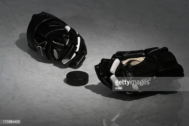 Black hockey equipment laying on an ice rink