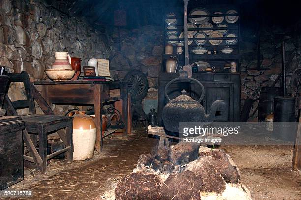 Black house Colbost Folk Museum Skye Highland Scotland A black house is a traditional Hebridean dwelling consisting of a double dry stone wall packed...