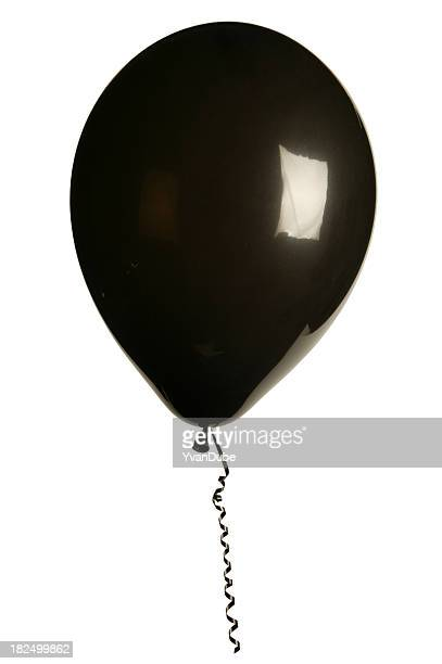 Black inflated shiny balloon with curled ribbon on white