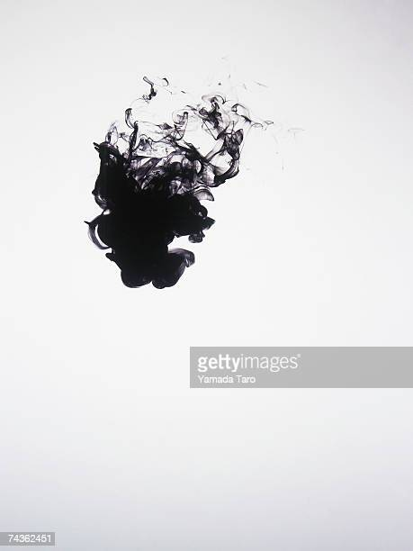 Black ink dissolving in water