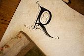 Black ink illuminated capital letter R
