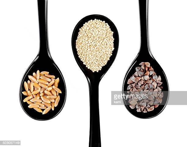 Black japanese style spoons with kamut wheat, quinoa, buckwheat