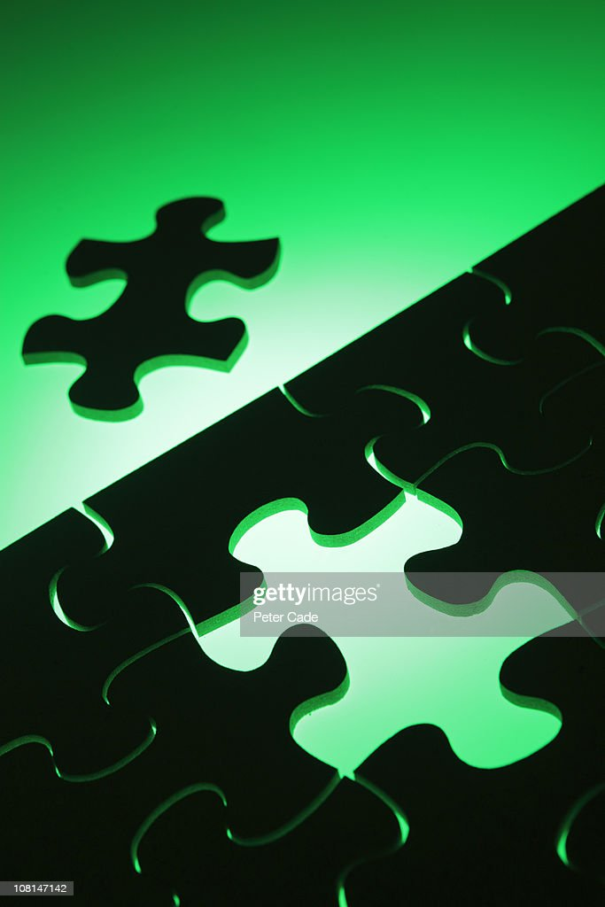 black jigsaw green background : Stock Photo