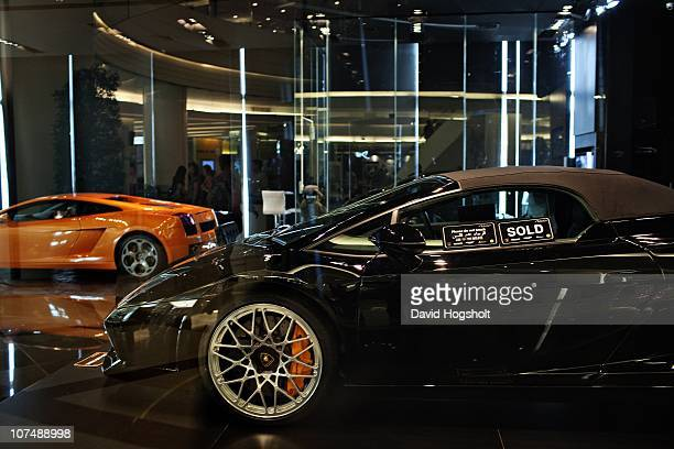 A black Lamborghini with a sign saying it has been sold sits on display in Paragon shopping mall December 3 2010 in Bangkok Thailand The BTS also...