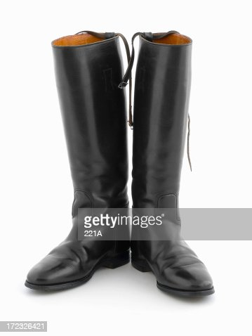 Black leather riding boots on white