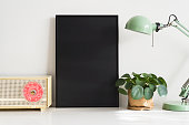 Black empty letter board template / mockup in living room