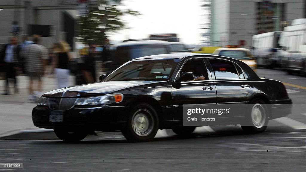 A black limousine-service car makes its way near Wall Street August 9, 2004 in New York City. Government officials have warned that intelligence points toward terrorists considering using tourist helicopters and Manhattan's ubiquitous limousine cars as possible attack vehicles on the city.
