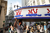 Black Lives Matter protesters hold a wooden coffin with an upside down donkey representing the Democratic party in downtown Philadelphia during the...