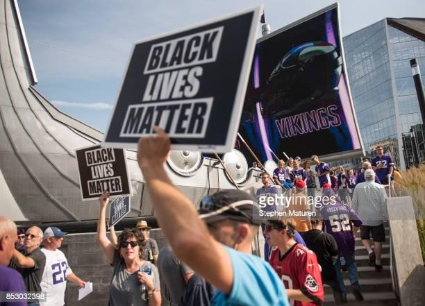 Black Lives Matter protestors rally outside the Minnesota Vikings game on September 24 2017 at US Bank Stadium in Minneapolis Minnesota The protest...