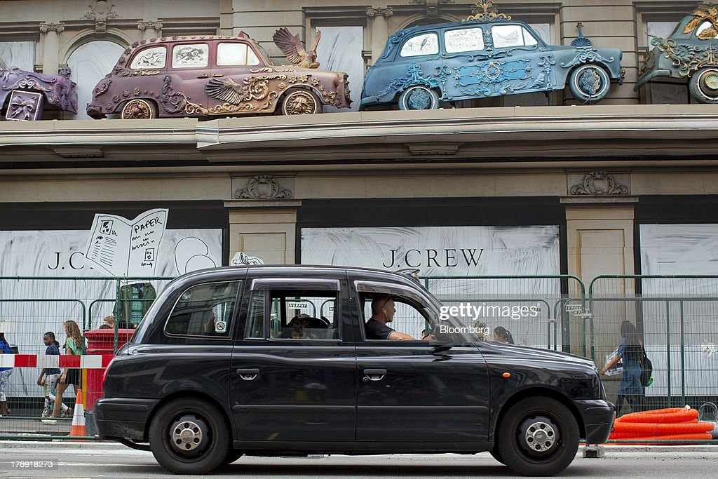 A black London taxi cab passes J.Crew Group Inc.'s new store on Regent Street which is due to open later this year in London, U.K., on Monday, Aug. 19, 2013. J. Crew's direct business, which accounts for 30 percent of its $2.2 billion in sales, now ships to more than 100 countries, up from 29 a year ago. Photographer: Jason Alden/Bloomberg via Getty Images