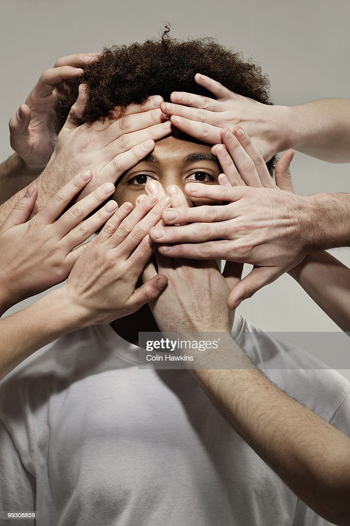 Black male hidden by hands : Stock Photo