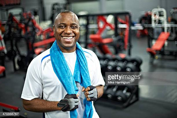Black Male in Gym, Smiling to Camera After Workout