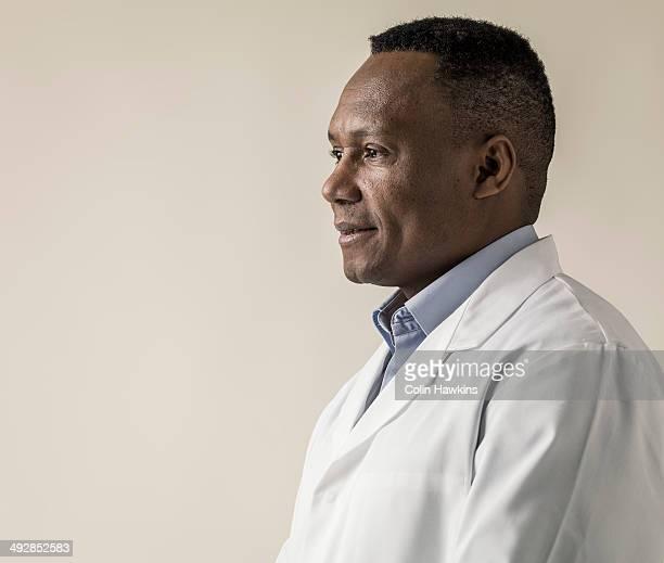 Black male in laboratory coat