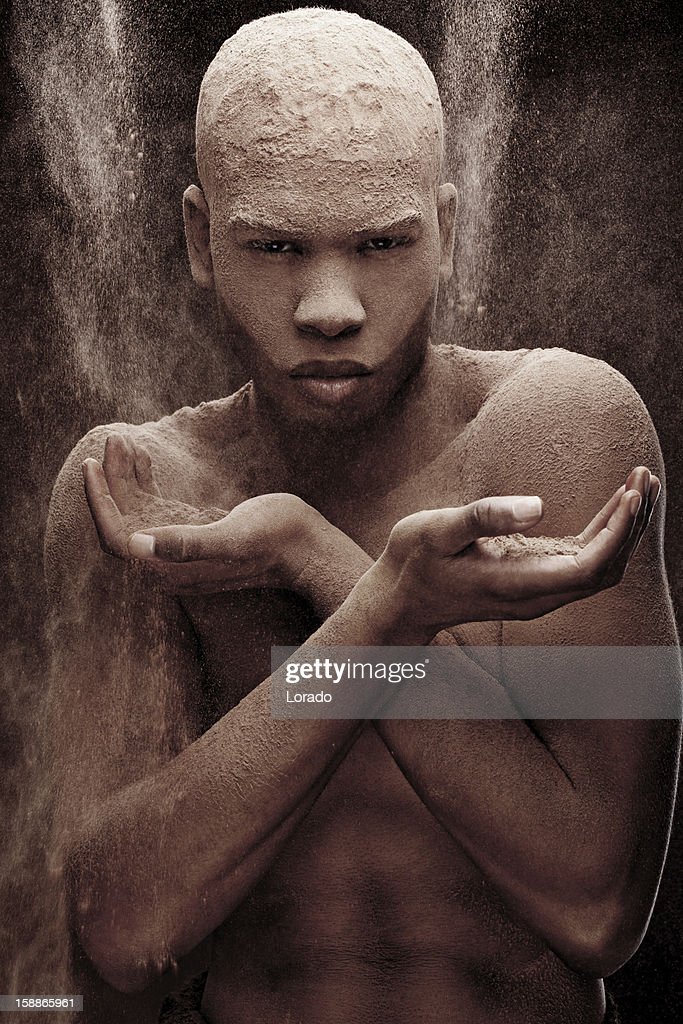 black male model covered with powder : Stock Photo