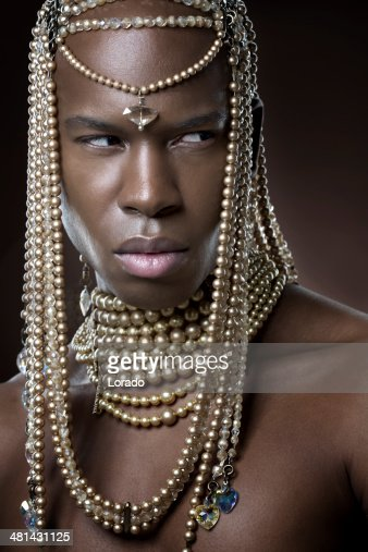 Black Male Model Posing With Luxury Jewelry Stock Photo