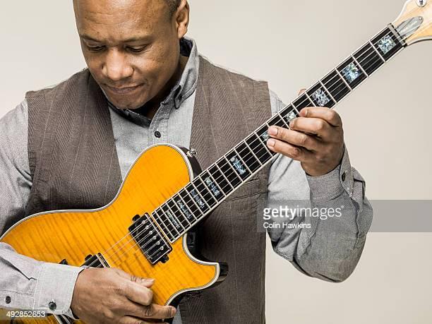 Black male playing guitar
