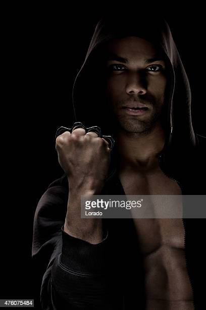Black male posing with a knuckle duster