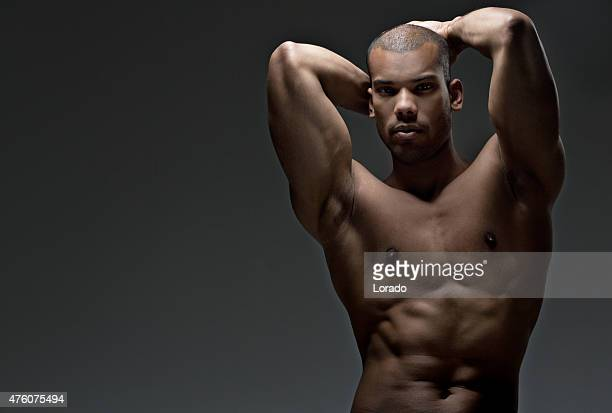 Black male posing with naked torso