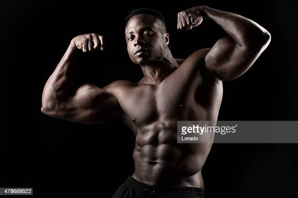 Black male posing with raised arms