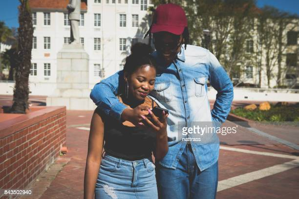 Black male shows his girlfriend a text message