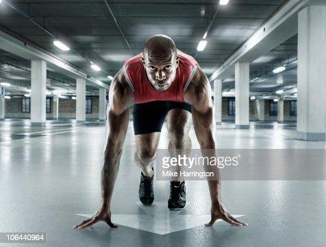 Black Male Sprinter In Starting Position