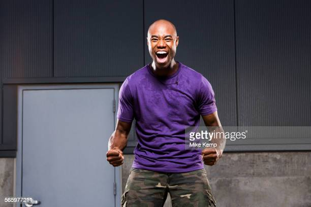 Black man cheering