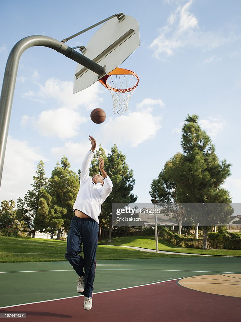 Black man playing basketball : Stock Photo