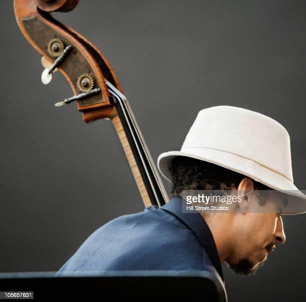 Black man playing bass