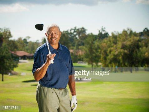 Black man playing golf : Stock Photo