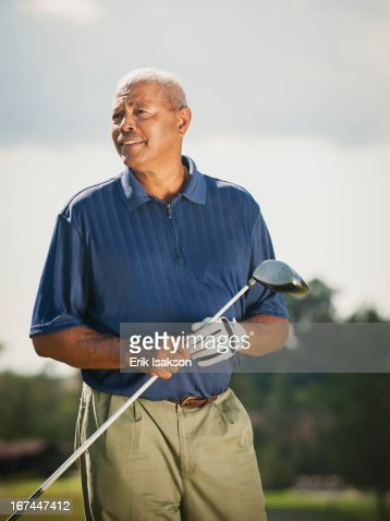 Black man playing golf : Stock Photo