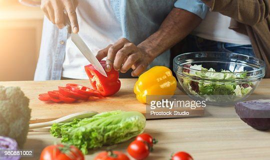 Black man preparing vegetable salad : Stock Photo